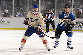 Rochester Amerks winger Dan Catenacci (45) skates past Lake Erie Monsters defensemen Karl Stollery (3) during the first period of The Frozen Frontier outdoor AHL game at Frontier Field on December 13, 2013 in Rochester, New York.  (Copyright Mike Janes Photography)
