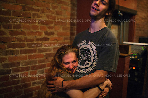 Scranton, Pennsylvania.July 31, 2012..Jacquelyn Purdy, who works as a bartender and online radio disk jockey, with Dave Brown, musician...Photograph by Alan Chin.