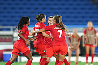Jessie Fleming #17 of Canada celebrates her goal from the penalty spot with her teammates