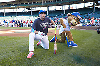 Chicago Cubs mascot stretches along side Triston Casas (26) of American Heritage High School in Pembroke Pines, Florida before the Under Armour All-American Game presented by Baseball Factory on July 29, 2017 at Wrigley Field in Chicago, Illinois.  (Jon Durr/Four Seam Images)