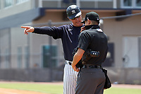 FCL Yankees manager Tyson Blaser (50) questions a call with umpire Takashi Wada during a game against the FCL Blue Jays on June 29, 2021 at the Yankees Minor League Complex in Tampa, Florida.  (Mike Janes/Four Seam Images)