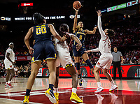 COLLEGE PARK, MD - DECEMBER 28: Kayla Robbins #5 of Michigan shoots over Blair Watson #22 of Maryland. during a game between University of Michigan and University of Maryland at Xfinity Center on December 28, 2019 in College Park, Maryland.