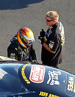 Aug 15, 2014; Brainerd, MN, USA; A crew member watches as NHRA funny car driver Jeff Arend gets ready during qualifying for the Lucas Oil Nationals at Brainerd International Raceway. Mandatory Credit: Mark J. Rebilas-