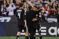 DC United midfielder Andy Najar (14) celebrates with Head Coach Ben Olsen the victory at the end of the game.   DC United defeated The Columbus Crew 3-1  at the home season opener, at RFK Stadium, Saturday March 19, 2011.