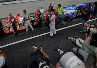 June 2, 2006; Dover, DE, USA; Members of the media photograph Nascar Nextel Cup driver Ricky Rudd (20) during qualifying for the Neighborhood Excellence 400 at Dover International Speedway. Rudd is replacing regular driver Tony Stewart (not pictured) who is recovering from injuries in last weeks race. Mandatory Credit: Mark J. Rebilas