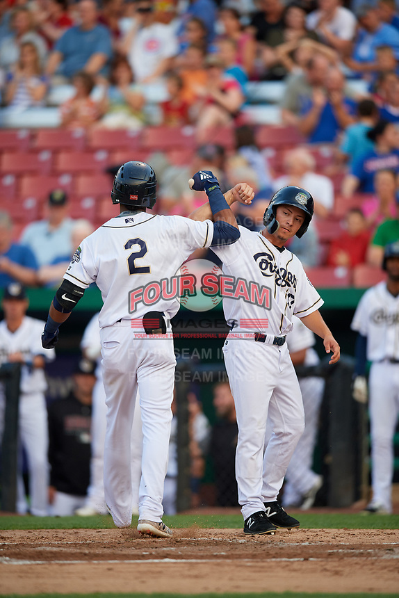 Kane County Cougars second baseman Yan Sanchez (2) is congratulated by right fielder Ernie De La Trinidad (17) after hitting a home run in the bottom of the fourth inning during a game against the South Bend Cubs on July 23, 2018 at Northwestern Medicine Field in Geneva, Illinois.  Kane County defeated South Bend 8-5.  (Mike Janes/Four Seam Images)