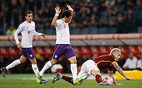 Calcio, Serie A: Roma vs Fiorentina. Roma, stadio Olimpico, 4 marzo 2016.<br /> Roma's Radja Nainggolan, right, is fouled by Fiorentina's Tino Costa  during the Italian Serie A football match between Roma and Fiorentina at Rome's Olympic stadium, 4 March 2016.<br /> UPDATE IMAGES PRESS/Riccardo De Luca