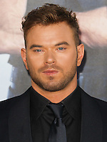 HOLLYWOOD, LOS ANGELES, CA, USA - AUGUST 11: Kellan Lutz arrives at the Los Angeles Premiere Of Lionsgate Films' 'The Expendables 3' held at the TCL Chinese Theatre on August 11, 2014 in Hollywood, Los Angeles, California, United States. (Photo by Celebrity Monitor)