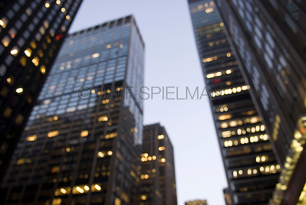 AVAILABLE FROM JEFF FOR COMMERCIAL AND EDITORIAL LICENSING.<br /> <br /> Soft Focus/Defocused View of Office Buildings on Sixth Avenue at Dusk, Midtown Manhattan, New York City, New York State, USA
