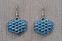 """A pair of chainmail earrings made from blue anodized 18 gauge aluminum rings  and 19 gauge 5/32"""" bright aluminum rings woven in a dragonscale pattern.  Made by Michelle."""