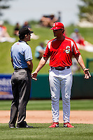Ron Warner (57) of the Springfield Cardinals argues with third base umpire Jimmy Volpi over a call at second base during a game against the San Antonio Missions on May 30, 2011 at Hammons Field in Springfield, Missouri.  Photo By David Welker/Four Seam Images