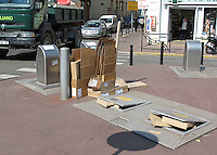 Re-cycling facilities in Cannes, France.  The collecting skips are below the street surface.