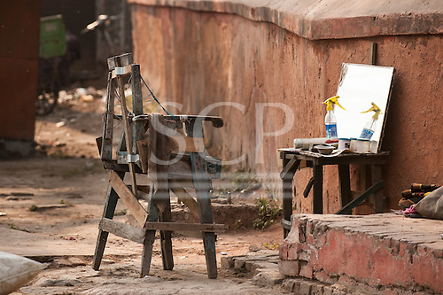 Agra, Utar Pradesh, India. Outdoor barber's  chair and mirror.
