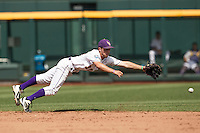 Louisiana State shortstop Alex Bregman (30) dives for a grounder against the North Carolina Tar Heels during Game 7 of the 2013 Men's College World Series on June 18, 2013 at TD Ameritrade Park in Omaha, Nebraska. The Tar Heels defeated the Tigers 4-2, eliminating LSU from the tournament. (Andrew Woolley/Four Seam Images)