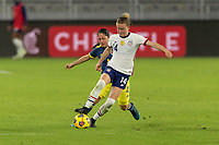 ORLANDO, FL - JANUARY 22: Emily Sonnett #14 turns away from the pressure by Diana Ospina #4 during a game between Colombia and USWNT at Exploria stadium on January 22, 2021 in Orlando, Florida.