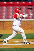 Trey DeRouen #8 of the Delaware State Hornets follows through on his swing against the Georgetown Hoyas at Gene Hooks Field on February 26, 2011 in Winston-Salem, North Carolina.  Photo by Brian Westerholt / Four Seam Images
