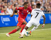 KANSAS CITY, KS - JUNE 26: Reggie Cannon #14 attacks against Jose Rodriguez #7 during a game between Panama and USMNT at Children's Mercy Park on June 26, 2019 in Kansas City, Kansas.