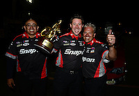 Nov. 11, 2012; Pomona, CA, USA: NHRA crew members for funny car driver Cruz Pedregon celebrate after winning the Auto Club Finals at at Auto Club Raceway at Pomona. Mandatory Credit: Mark J. Rebilas-
