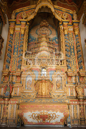 Penedo, Alagoas State, Brazil. Inside baroque church, gold and colouful altar.