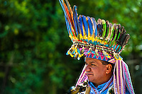 """A Colombian Kamentsá shaman, wearing a colorful feather headgear, takes part in the Carnival of Forgiveness, a traditional indigenous celebration in Sibundoy, Colombia, 12 February 2013. Clestrinye (""""Carnaval del Perdón"""") is a ritual ceremony kept for centuries in the Valley of Sibundoy in Putumayo (the Amazonian department of Colombia), a home to two closely allied indigenous groups, the Inga and Kamentsá. Although the festival has indigenous origins, the Catholic religion elements have been introduced and merged with the shamanistic tradition. Celebrating annually the collaboration, peace and unity between tribes, they believe that anyone who offended anyone may ask for forgiveness this day and all of them should grant pardons."""