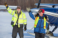Volunteer Iditarod Air Force pilots, Dr. Bill Mayer and Bruce Moroney signal the OK to a taxing pilot at the Willow, Alaska airport during the Food Flyout on Saturday, February 20, 2016.  Iditarod 2016