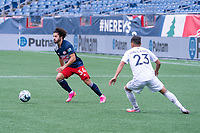 FOXBOROUGH, MA - JULY 4: Ryan Spaulding #34 of the New England Revolution II looking for an opening as he moves to the midfield during a game between Greenville Triumph SC and New England Revolution II at Gillette Stadium on July 4, 2021 in Foxborough, Massachusetts.
