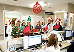 WATERBURY, CT-121917JS07---Nurses and nursing supervisors at Waterbury Hospital, went from floor to floor on Tuesday singing Christmas carols for staff and patients at the hospital. The nursing station on each floor were also presented with a box of chocolates for the staff. <br /> Jim Shannon Republican-American