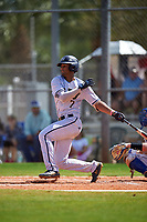 FIU Panthers shortstop John Rodriguez (7) bats during a game against the South Dakota State Jackrabbits on February 23, 2019 at North Charlotte Regional Park in Port Charlotte, Florida.  South Dakota defeated FIU 4-3.  (Mike Janes/Four Seam Images)