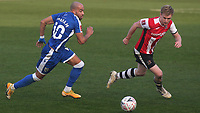 Jordan Graham of Gillingham takes on Jack Sparkes of Exeter City during Gillingham vs Exeter City, Emirates FA Cup Football at the MEMS Priestfield Stadium on 28th November 2020