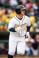 Montgomery Biscuits catcher Jake DePew (23) runs to first during a game against the Jackson Generals on April 29, 2015 at Riverwalk Stadium in Montgomery, Alabama.  Jackson defeated Montgomery 4-3.  (Mike Janes/Four Seam Images)