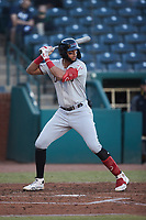 Pedro Gonzalez (4) of the Hickory Crawdads at bat against the Greensboro Grasshoppers at First National Bank Field on May 6, 2021 in Greensboro, North Carolina. (Brian Westerholt/Four Seam Images)