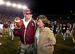 With his arm around his wife, Ann, and pitching the game ball in the air, Florida State head coach Bobby Bowden leaves the field the winningest active Division 1 college football coach in America wtih 339 wins. His Seminoles defeated Wake Forest, 48-22, in Tallahassee October 25, 2003.  (Mark Wallheiser/TallahasseeStock.com)