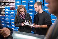 """Adidas-BVG-Turnschuh.<br /> Verkauf des Adidas-BVG-Turnschuh """"Sneaker EQT Support 93"""", im Berliner Turnschuhgeschaeft """"Overkill"""" am Dienstag den 16. Januar 2018.<br /> Der Turnschuh, der auch bis zum 31.12.2018 als BVG-Jahreskarte gueltig ist, wird in einer limitierten Auflage von 500 Stueck verkauft. Jugendlichen und professionelle eBay-Haendler sind bereits seit zwei Tagen Vorort um den Turnschuh fuer 180,- Euro zu kaufen. Die eBay-Haendler wollen den Turnschuh fuer mind. 2.000,-€ verkaufen.<br /> Im Bild vlnr.: Die BVG-Chefin Dr. Sigrid Nikutta und Till<br /> Jagla, Senior Director bei adidas Originals mit dem BVG-Adidas-Turnschuh.<br /> 16.1.2018, Berlin<br /> Copyright: Christian-Ditsch.de<br /> [Inhaltsveraendernde Manipulation des Fotos nur nach ausdruecklicher Genehmigung des Fotografen. Vereinbarungen ueber Abtretung von Persoenlichkeitsrechten/Model Release der abgebildeten Person/Personen liegen nicht vor. NO MODEL RELEASE! Nur fuer Redaktionelle Zwecke. Don't publish without copyright Christian-Ditsch.de, Veroeffentlichung nur mit Fotografennennung, sowie gegen Honorar, MwSt. und Beleg. Konto: I N G - D i B a, IBAN DE58500105175400192269, BIC INGDDEFFXXX, Kontakt: post@christian-ditsch.de<br /> Bei der Bearbeitung der Dateiinformationen darf die Urheberkennzeichnung in den EXIF- und  IPTC-Daten nicht entfernt werden, diese sind in digitalen Medien nach §95c UrhG rechtlich geschuetzt. Der Urhebervermerk wird gemaess §13 UrhG verlangt.]"""