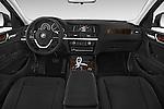Stock photo of straight dashboard view of 2017 BMW X4 xDrive28i 5 Door SUV Dashboard