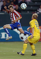September 3, 2005 Photo by Matt A. Brown/ISI.Chivas USA (19) Matt Taylor kick the ball against Columbus Crew's (23) David Testo in the first half.