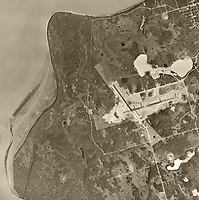 historical aerial photo map of the Ted Stevens Anchorage International airport under constructionand Lake Hood Seaplane Base, Anchorage, Alaska, 1950.  The airport opened the following year, 1951.