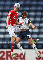 1st May 2021; Deepdale Stadium, Preston, Lancashire, England; English Football League Championship Football, Preston North End versus Barnsley; Mads Juel Andersen of Barnsley wins a header challenged by Ched Evans of Preston North End