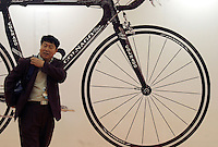 A visitor walks past a giant bicycle poster at the 14th China International Bicycle Fair in Shanghai, China. Despite the government's push to promote automobile ownership, the bicycle remains the most popular mode of transportation for China's masses. However gone are the ubiquitous and simple clunkers of the old days, more are looking into newer, lighter, and fancier models..14-APR-04