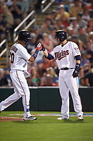Minnesota Twins second baseman Brian Dozier (2) fist bumps Eddie Rosario (20) after a home run during a Spring Training game against the Boston Red Sox on March 16, 2016 at Hammond Stadium in Fort Myers, Florida.  Minnesota defeated Boston 9-4.  (Mike Janes/Four Seam Images)