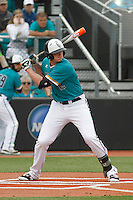 University of Coastal Carolina Chanticleers first baseman Kevin Woodall, Jr. (19) at bat during a game against the University of Virginia Cavaliers at Springs Brooks Stadium on February 21, 2016 in Conway, South Carolina. Coastal Carolina defeated Virginia 5-4. (Robert Gurganus/Four Seam Images)