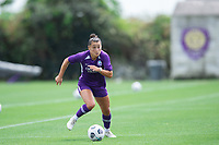 SANFORD, FL - APRIL 3: Ali Riley of the Orlando Pride dribbles the ball during a game between Florida State Seminoles and Orlando Pride at Sylvan Park Training Center on April 3, 2021 in Sanford, Florida.