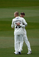 16th April 2021; Emirates Old Trafford, Manchester, Lancashire, England; English County Cricket, Lancashire versus Northants; Matt Parkinson of Lancashire celebrates with Josh Bohannon after Bohannon caught Luke Procter of Northamptonshire off his bowling