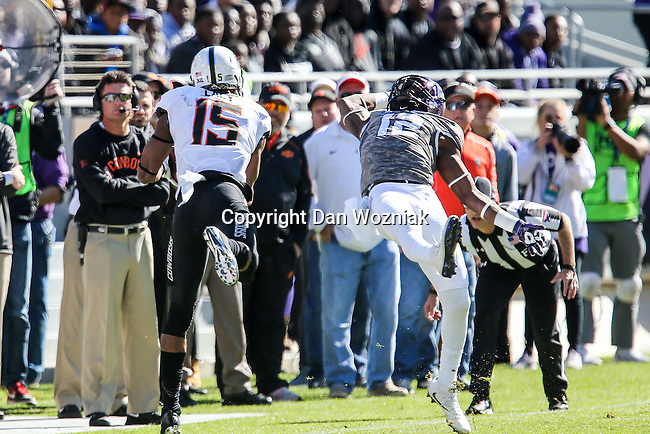 TCU Horned Frogs cornerback Jeff Gladney (12) and Oklahoma State Cowboys wide receiver Chris Lacy (15) in action during the game between the Oklahoma State Cowboys and the TCU Horned Frogs at the Amon G. Carter Stadium in Fort Worth, Texas.