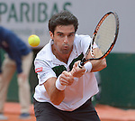 Pablo Andujar (ESP) battles against Jo-Wilfried Tsonga (FRA at  Roland Garros being played at Stade Roland Garros in Paris, France on May 29, 2015