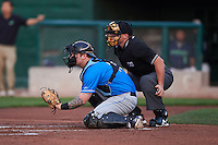 Hudson Valley Renegades catcher Taylor Hawkins (15) and umpire Greg Roemer during a game against the Vermont Lake Monsters on September 3, 2015 at Centennial Field in Burlington, Vermont.  Vermont defeated Hudson Valley 4-1.  (Mike Janes/Four Seam Images)