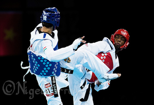 10 AUG 2012 - LONDON, GBR - Lutalo Muhammad (GBR) (right) of Great Britain and Farkhod Negmatov of Tajikistan trade kicks during their men's -80kg category preliminary round contest at the London 2012 Olympic Games Taekwondo at Excel in London, Great Britain (PHOTO (C) 2012 NIGEL FARROW)