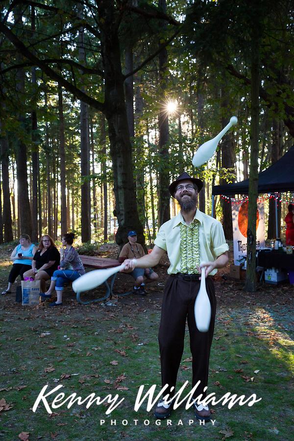 Juggler at Sunset, Arts A Glow Festival, Dottie Harper Park, Burien, Washington State, WA, America, USA.