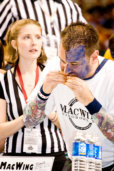 """""""MacWing"""" at the 14th annual Wing Bowl, held in Philadelphia on February 3, 2006 at the Wachovia Center.<br /> <br /> The Wing Bowl is a competitive eating event in which eaters try and down the most hot wings in 30 total minutes in front of a crowd of 10,000 plus people.  The real show however is all around the eaters, from the various scantily clad women (known as """"Wingettes"""") that make up eaters' entourages, to the behavior of the fans themselves."""