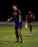 United States head coach Wilmer Cabrera talks to the referee from the sideline during the semifinals of the CONCACAF Men's Under 17 Championship at Catherine Hall Stadium in Montego Bay, Jamaica. The United States defeated Jamaica, 2-0.