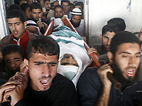 "Palestinian carry the boday  of nineteen-year-old Muhammad Al-Najjar was riddled with 13 bullets Undercover Israeli forces killed a teenage Palestinian civilian and injured four others in the southern Gaza Strip town of Khuza'a on Tuesday morning.<br /> Palestinian medical sources said .""photo by Fady Adwan"""